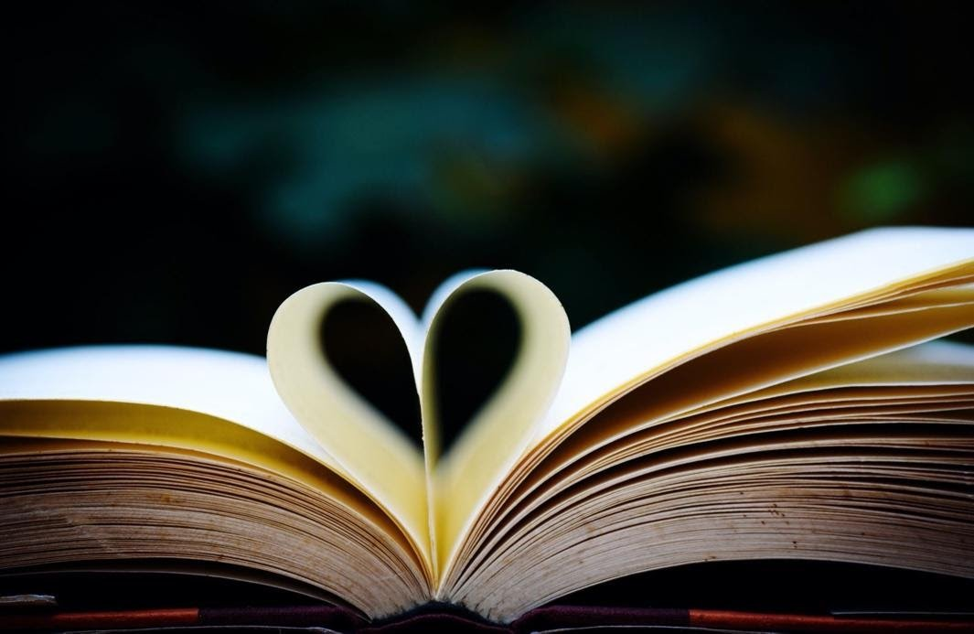 Open book with pages turned in to form a heart